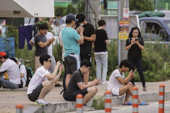 手游的便捷性,吸引了大量玩家。图/视觉中国